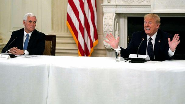 PHOTO: President Donald Trump tells reporters that he is taking zinc and hydroxychloroquine during a meeting with restaurant industry executives about the coronavirus response, in the State Dining Room of the White House, May 18, 2020. (Evan Vucci/AP)