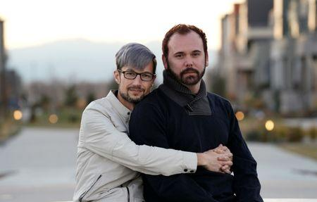 Gay married couple David Mullins (L) and Charlie Craig pose for a photo in Denver, Colorado, U.S. November 28, 2017. REUTERS/Rick Wilking
