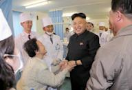 An undated picture released by North Korea's official Korean Central News Agency on March 22, 2014 showing North Korean leader Kim Jong-Un during a visit to a dental hospital in Pyongyang