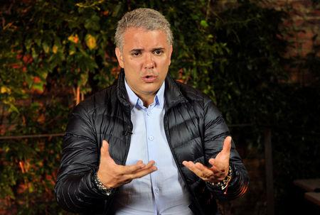 Colombian presidential candidate of the Democratic Center party Ivan Duque gestures during an interview with Reuters in Bogota