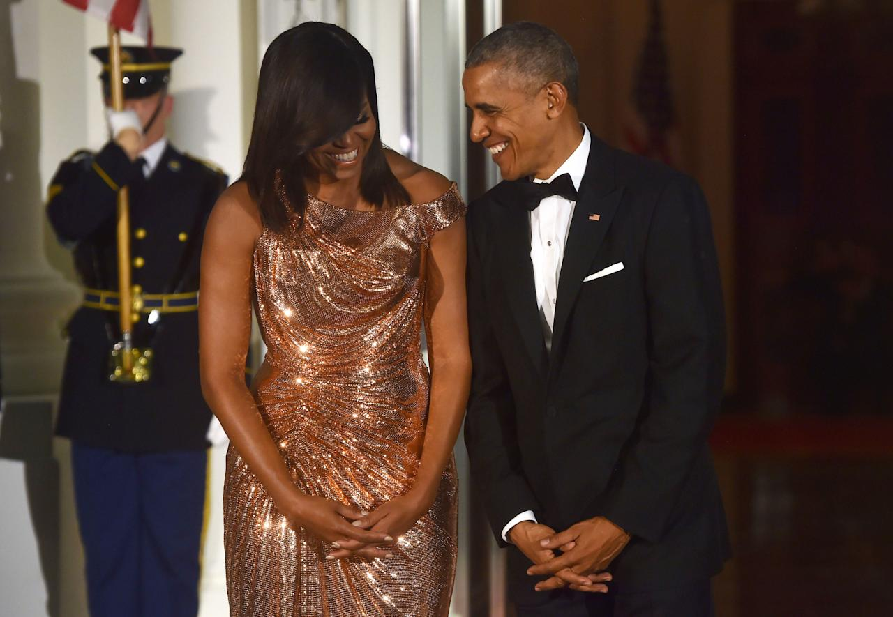 <p>Talk about going out with a bang. Michelle looked *flawless*<span></span> in a rose gold Atelier Versace gown. The dress plus the flirty laughter between Michelle and Barack reminded us why we'll miss them so much: they are the ultimate #goals.</p><p><span></span></p>