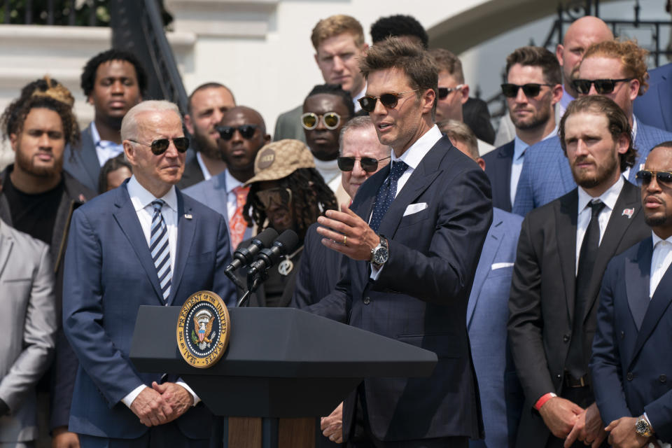 President Joe Biden listens to Tampa Bay Buccaneers quarterback Tom Brady speak during a ceremony on the South Lawn of the White House, in Washington, Tuesday, July 20, 2021, where the president honored the Super Bowl Champion Tampa Bay Buccaneers for their Super Bowl LV victory. (AP Photo/Manuel Balce Ceneta)