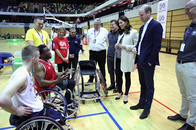 REFILE - CORRECTING CATHERINE'S TITLE Britain's Prince William and Catherine, Duchess of Cambridge, meet wheelchair basketball players, some of whom hope to compete in the 2022 Commonwealth Games in Birmingham, during their visit to the Copper Box in the Olympic Park in Stratford, London, Britain, March 22, 2018. Chris Jackson/Pool via Reuters