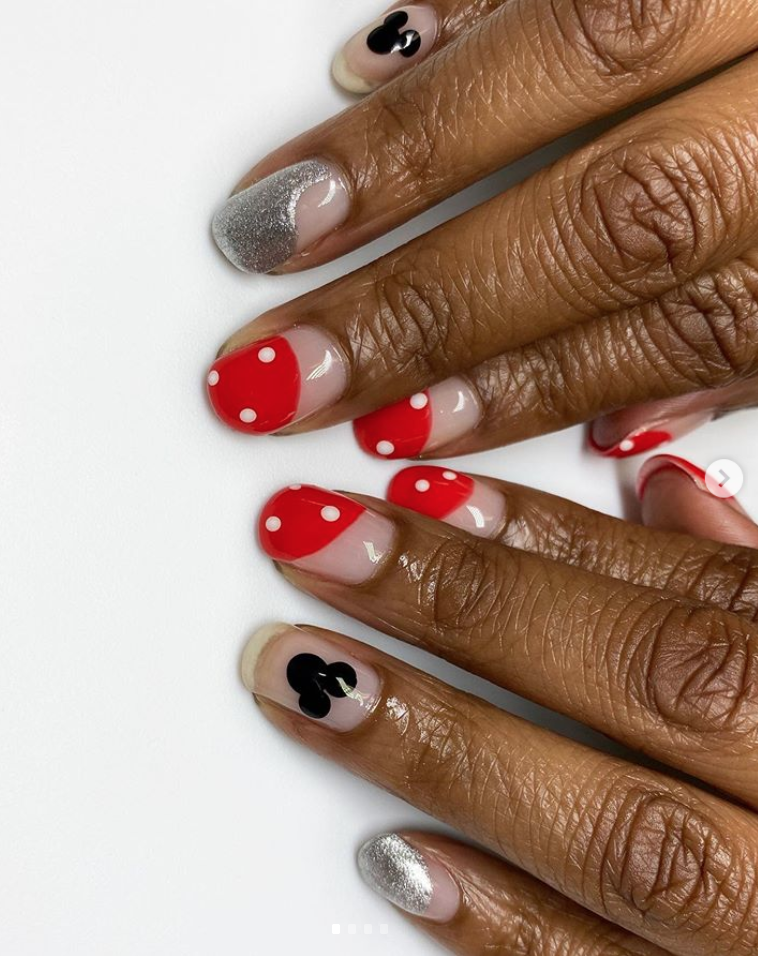 """<p>Going for a Disney theme? Try <a href=""""https://www.instagram.com/p/B5i5wXXgNzo/"""" rel=""""nofollow noopener"""" target=""""_blank"""" data-ylk=""""slk:nail artist Canishiea J. Sams"""" class=""""link rapid-noclick-resp"""">nail artist Canishiea J. Sams</a>'s oh-so-cute Minnie and Mickey Mouse nails, with swoops of red and silver. <br></p><p><a class=""""link rapid-noclick-resp"""" href=""""https://go.redirectingat.com?id=74968X1596630&url=https%3A%2F%2Fwww.etsy.com%2Flisting%2F239597845%2F36-mickey-mouse-ears-nail-decals&sref=https%3A%2F%2Fwww.oprahmag.com%2Fbeauty%2Fskin-makeup%2Fg33239588%2Fhalloween-nail-ideas%2F"""" rel=""""nofollow noopener"""" target=""""_blank"""" data-ylk=""""slk:SHOP NAIL DECAL"""">SHOP NAIL DECAL</a></p>"""
