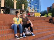 """Isabelle Eley and her boyfriend Benjamin Green sit in Pioneer Courthouse Square, Aug. 27, 2020 in Portland, Ore. Green, a forklift operator in the Portland suburb of Beaverton, said he felt safe in the city and enjoyed his visit despite boarded up windows and graffiti from recent protests. """"It's a pretty day and we feel just perfectly safe as long as we've got our masks on,"""" said Green. """"I don't see why there's any need to be scared to walk around out here."""" (AP Photo/Gillian Flaccus)"""