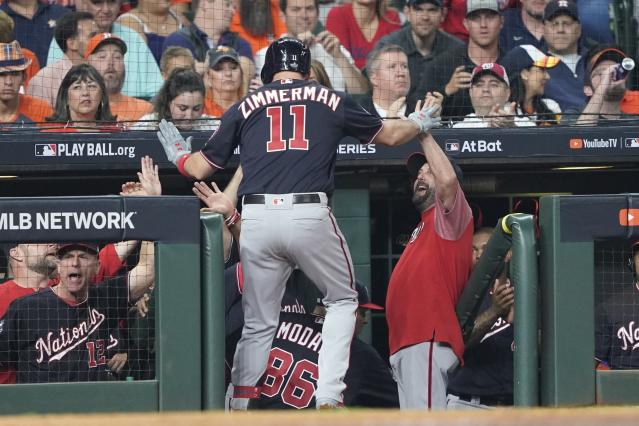 Washington Nationals' Ryan Zimmerman is congratulated after hitting a home run during the second inning of Game 1 of the baseball World Series against the Houston Astros Tuesday, Oct. 22, 2019, in Houston. (AP Photo/David J. Phillip)