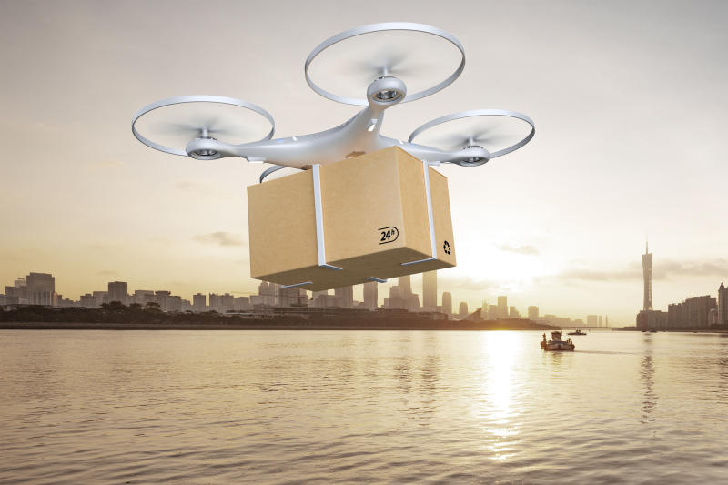 Drone delivering package over cityscape,3d render