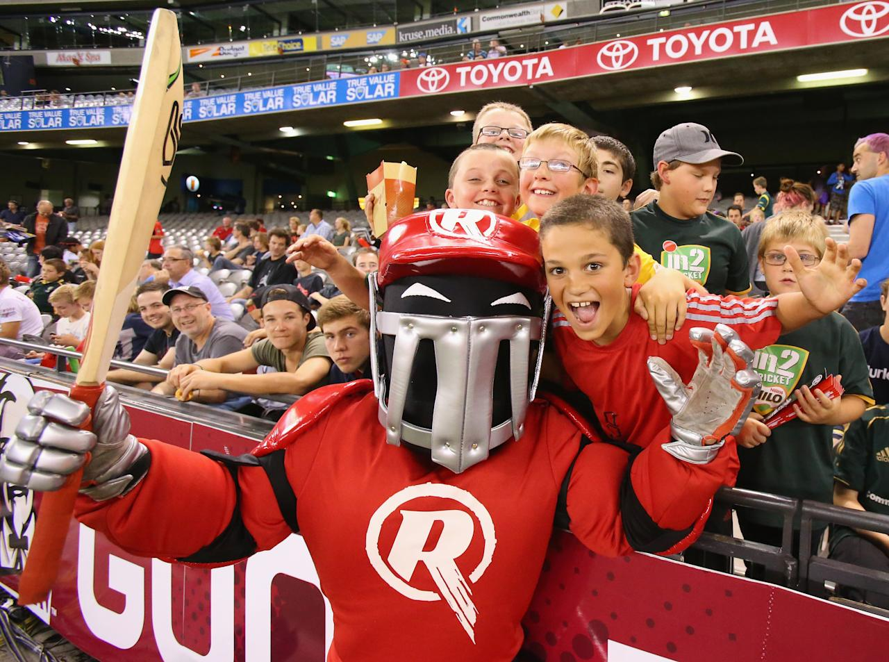MELBOURNE, AUSTRALIA - DECEMBER 19:  The Renegades mascot poses with fans during the Big Bash League match between the Melbourne Renegades and the Hobart Hurricanes at Etihad Stadium on December 19, 2012 in Melbourne, Australia.  (Photo by Scott Barbour/Getty Images)