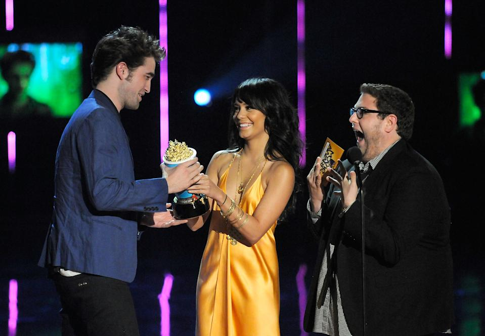 UNIVERSAL CITY, CA - MAY 31:  Actors Robert Pattinson, Vanessa Hudgens and Jonah Hill onstage during the 2009 MTV Movie Awards held at the Gibson Amphitheatre on May 31, 2009 in Universal City, California.  (Photo by Kevin Mazur/WireImage)