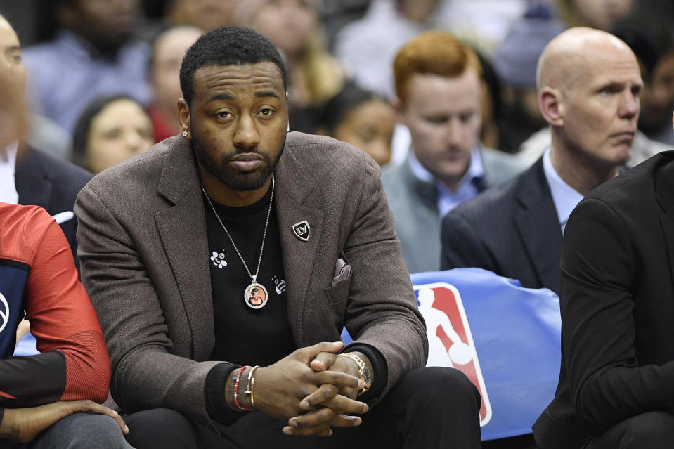 Washington Wizards guard John Wall sits on the bench during the first half of a game the day after he reportedly fell at his home. (AP Photo/Nick Wass)