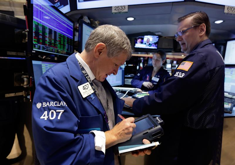 Stocks inch lower as market waits Fed decision