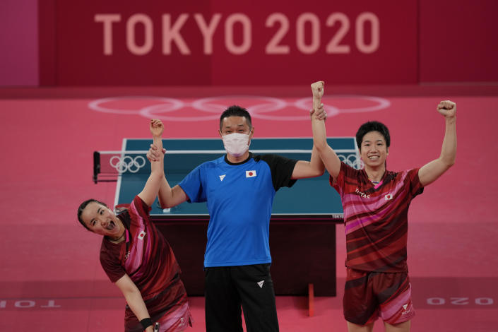 Japan's Mima Ito, left, and Jun Mizutani celebrate after winning the table tennis mixed doubles gold medal match against China's Xu Xin and Liu Shiwen at the 2020 Summer Olympics, Monday, July 26, 2021, in Tokyo. (AP Photo/Kin Cheung)