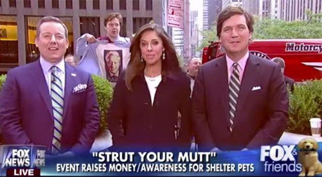 The man, appearing to be in his early 20s, can be seen shouting 'Bill Clinton is a racist' wearing a t-shirt with the ex-president's face on it above the word 'RAPE' during a live Fox News broadcast. Picture: Fox News