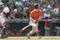 Houston Astros' Kyle Tucker watches his two-run home run, next to Seattle Mariners catcher Tom Murphy, during the eighth inning of a baseball game Wednesday, July 28, 2021, in Seattle. (AP Photo/Jason Redmond)