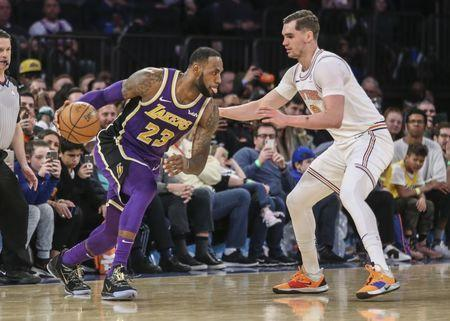 FILE PHOTO: Mar 17, 2019; New York, NY, USA; Los Angeles Lakers forward LeBron James (23) drives past New York Knicks forward Mario Hezonja (8) in the fourth quarter at Madison Square Garden. Mandatory Credit: Wendell Cruz-USA TODAY Sports