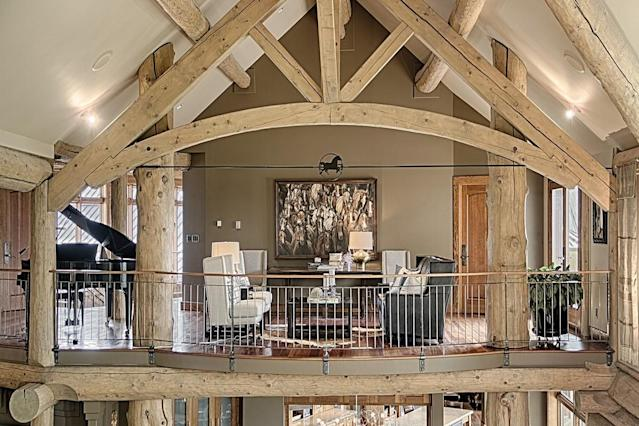 "<p>Inside the main home, the 11,800-square-foot log building has lots of exposed beams and open, airy spaces, accented by limestone. (Listing via <a href=""http://sothebysrealty.ca/en/property/alberta/calgary-real-estate/calgary/63209/"" rel=""nofollow noopener"" target=""_blank"" data-ylk=""slk:Sotheby's Canada"" class=""link rapid-noclick-resp"">Sotheby's Canada</a>) </p>"