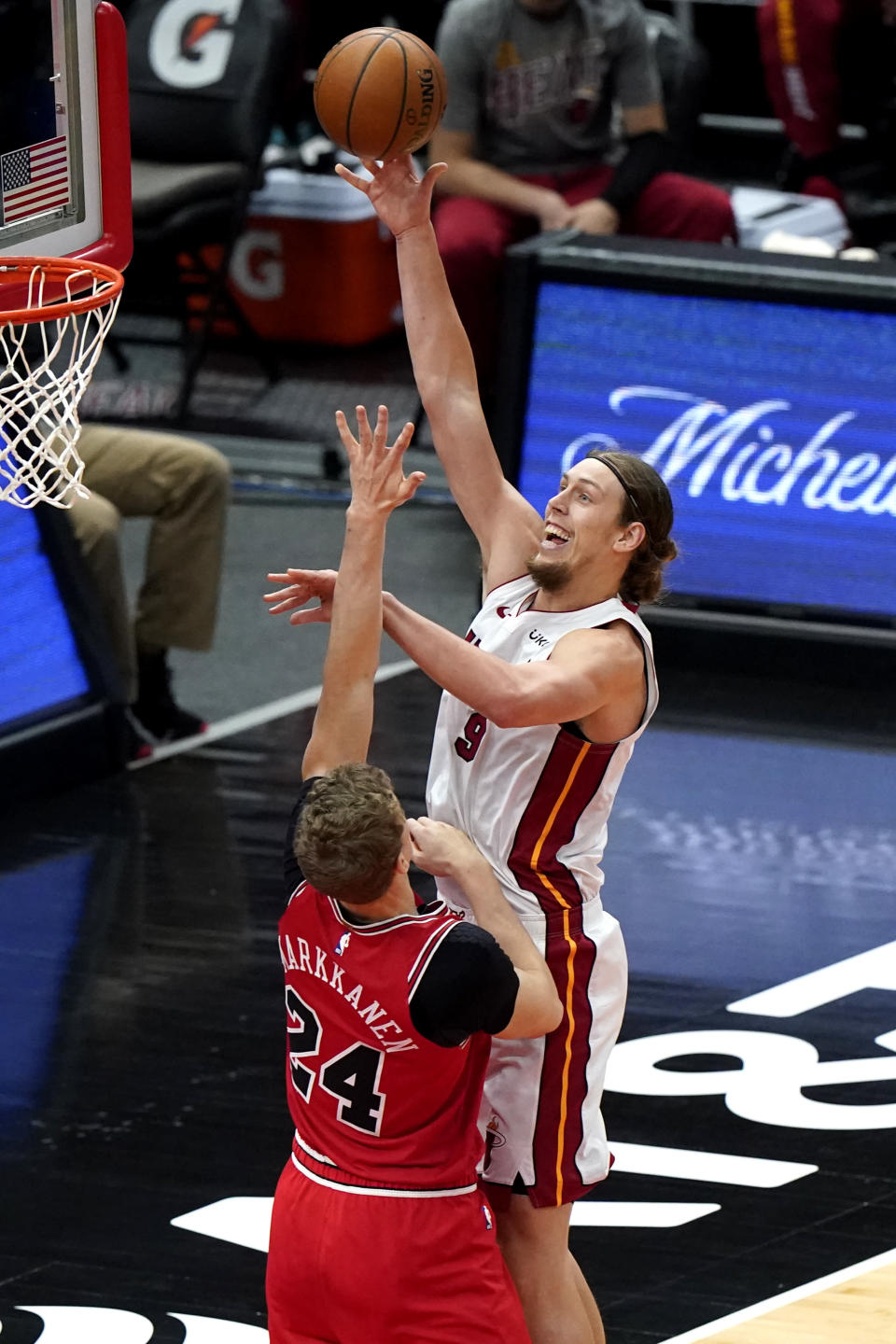 Miami Heat forward Kelly Olynyk, right, goes up to shoot against Chicago Bulls forward Lauri Markkanen during the first half of an NBA basketball game in Chicago, Friday, March 12, 2021. (AP Photo/Nam Y. Huh)