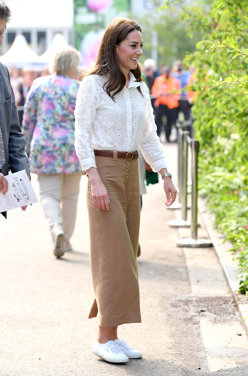 The Duchess of Cambridge wore her favourite white Superga trainers at the RHS Chelsea Flower Show earlier this year. (Picture: Getty Images)