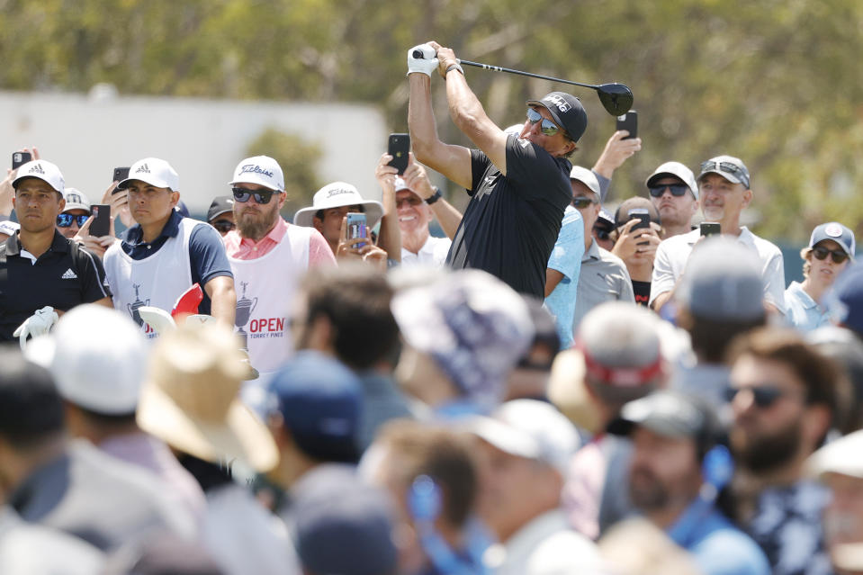 SAN DIEGO, CALIFORNIA - JUNE 17: Phil Mickelson of the United States plays his shot from the 18th tee surrounded by a gallery of fans during the first round of the 2021 U.S. Open at Torrey Pines Golf Course (South Course) on June 17, 2021 in San Diego, California. (Photo by Ezra Shaw/Getty Images)