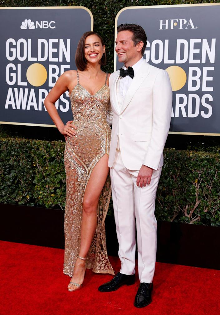 Happy couple: Bradley Cooper and his girlfriend Irina Shayk at the Golden Globes (Reuters)
