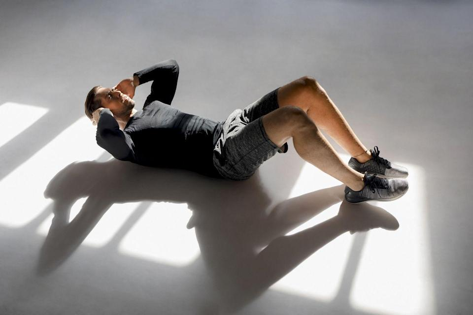 """<p><strong>You'll need: Floor space</strong></p><p>Put together by the master of <a href=""""https://www.menshealth.com/uk/bodyweight-exercises/"""" rel=""""nofollow noopener"""" target=""""_blank"""" data-ylk=""""slk:bodyweight workouts"""" class=""""link rapid-noclick-resp"""">bodyweight workouts</a> <a href=""""https://www.instagram.com/bradleysimmonds/?hl=en"""" rel=""""nofollow noopener"""" target=""""_blank"""" data-ylk=""""slk:Bradley Simmonds"""" class=""""link rapid-noclick-resp"""">Bradley Simmonds</a>, perform the four moves back-to -back for four total rounds, taking only 60 seconds rest at the end of each circuit. Let's be honest, revealing a defined <a href=""""https://www.menshealth.com/uk/workouts/g753855/10-minute-six-pack-challenge/"""" rel=""""nofollow noopener"""" target=""""_blank"""" data-ylk=""""slk:six-pack"""" class=""""link rapid-noclick-resp"""">six-pack</a> in time for summer is something we all have time for during lockdown.<br></p><p><strong>1) Leg Raise, 45sec work, no rest</strong><br><br>Start by targeting your stubborn lower abs while you're still fresh. Lie on your back with your hands relaxed by your sides, legs extended. Keeping your legs straight, raise them to form a right angle with the floor. Lower back to the ground, under control. Repeat for 45 seconds, favouring proper form over speed.</p><p><strong><strong>2) V-Sit Crunch</strong>, 45sec work, no rest</strong></p><p>Lie face up as before, with your legs out straight. Now lift them and your torso just off the floor, with your hands at the side of your head. This forces you to engage your abs for the whole rep. Lift your torso and bend your knees, pulling them to your chest. Lower, maintaining control.<br></p><p><strong><strong>3) Bicycle crunch</strong>, 45sec work, no rest</strong></p><p>With your hands on the sides of your forehead, shoulders off the floor and legs bent, twist your upper body quickly to the left, pulling your left knee to touch your elbow, as you straighten your right leg. Return, and then repeat on your right side. Keep on pedalling for the """