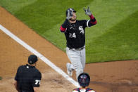 Chicago White Sox's Yasmani Grandal (24) celebrates as he scores on his two run home run in the third inning of a baseball game Tuesday, May 18, 2021, in Minneapolis. (AP Photo/Jim Mone)