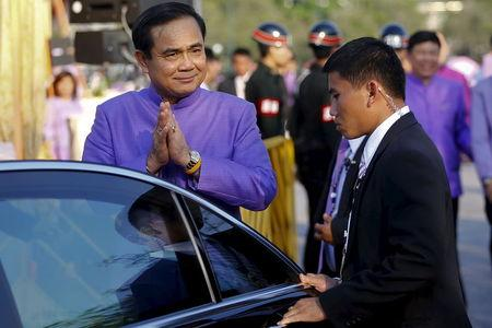 Thailand's Prime Minister Prayuth Chan-ocha gestures the traditional greeting as he gets in his car after the merit-making ceremony on the occasion of Princess Maha Chakri Sirindhorn's birthday at Sanam Luang in Bangkok