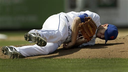 New York Mets starting pitcher Jeremy Hefner falls to the ground after being hit by a line drive from St. Louis Cardinals' Carlos Beltran during the fourth inning of an exhibition spring training baseball game Tuesday, March 26, 2013, in Port St. Lucie, Fla. Hefner left the game. (AP Photo/Jeff Roberson)