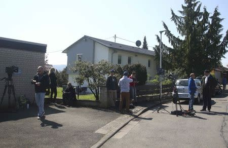 Media gather near a house were the German police arrested a man who is suspected of planting explosives targeting the bus of soccer team Borussia Dortmund is pictured in the town Rottenburg