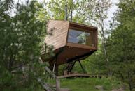 """<p>If you want a more low-key treetop experience, book your stay at this <a href=""""https://go.redirectingat.com/?id=74968X1525080&xs=1&url=https%3A%2F%2Fwww.airbnb.com%2Frooms%2F13761529%3Fguests%3D1%26adults%3D1&sref=https%3A%2F%2Fwww.housebeautiful.com%2Flifestyle%2Fg25781535%2Fnature-travel-hotels%2F"""" rel=""""nofollow noopener"""" target=""""_blank"""" data-ylk=""""slk:Airbnb"""" class=""""link rapid-noclick-resp"""">Airbnb</a>. It features midcentury modern interiors, a spacious living area, and a panoramic window that overlooks a lake. It's only fifteen minutes outside of Woodstock, New York, too, so you'll be able to explore the cute downtown area while you're here.</p><p><a class=""""link rapid-noclick-resp"""" href=""""https://go.redirectingat.com/?id=74968X1525080&xs=1&url=https%3A%2F%2Fwww.airbnb.com%2Frooms%2F13761529%3Fguests%3D1%26adults%3D1&sref=https%3A%2F%2Fwww.housebeautiful.com%2Flifestyle%2Fg25781535%2Fnature-travel-hotels%2F"""" rel=""""nofollow noopener"""" target=""""_blank"""" data-ylk=""""slk:BOOK NOW"""">BOOK NOW</a> <strong><em>Willow Treehouse</em></strong></p>"""