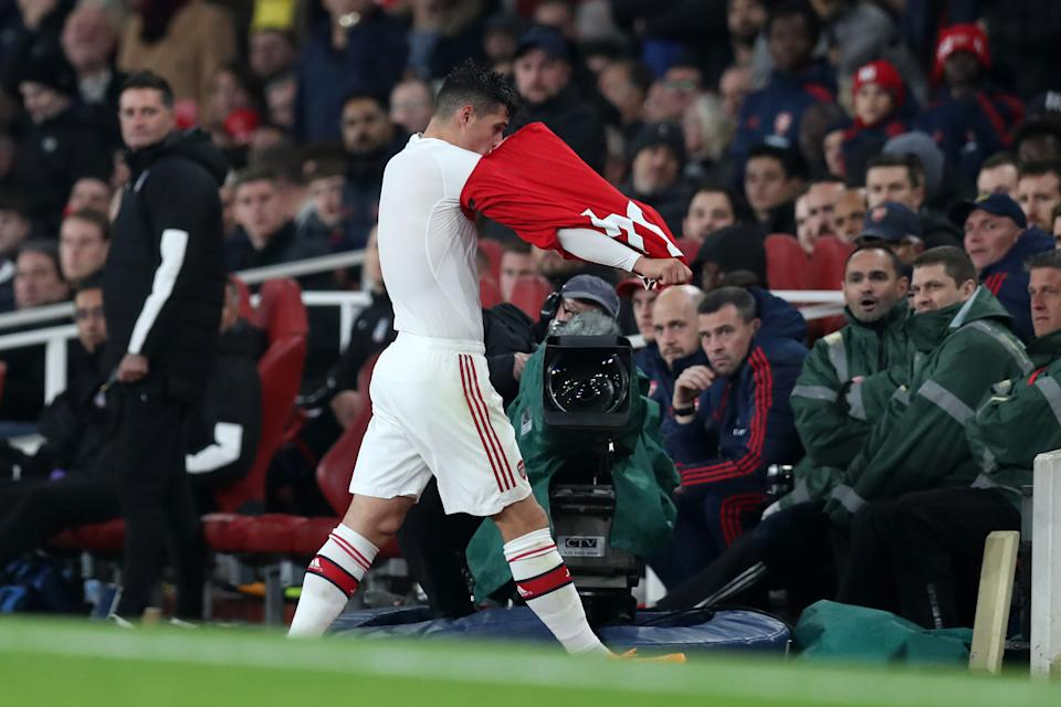 Arsenal's Granit Xhaka takes off his jersey and heads down the tunnel after being substituted on Sunday. (Getty)