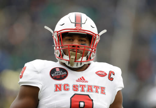 FILE - In this Oct. 28, 2017 file photo North Carolina State's Bradley Chubb warms up for an NCAA college football game against Notre Dame in South Bend, Ind. Chubb is a top prospect in the upcoming NFL draft. (AP Photo/Darron Cummings)