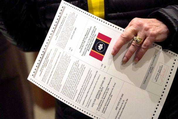 PHOTO: A voter holds a ballot during Election Day in Ridgeland, Miss, on Nov. 3, 2020. In addition to the presidential race and the U.S. Senate race, the  electorate also voted on a few more initiatives, including one of two medical marijuana initiatives. (Rogelio V. Solis/AP, FILE)