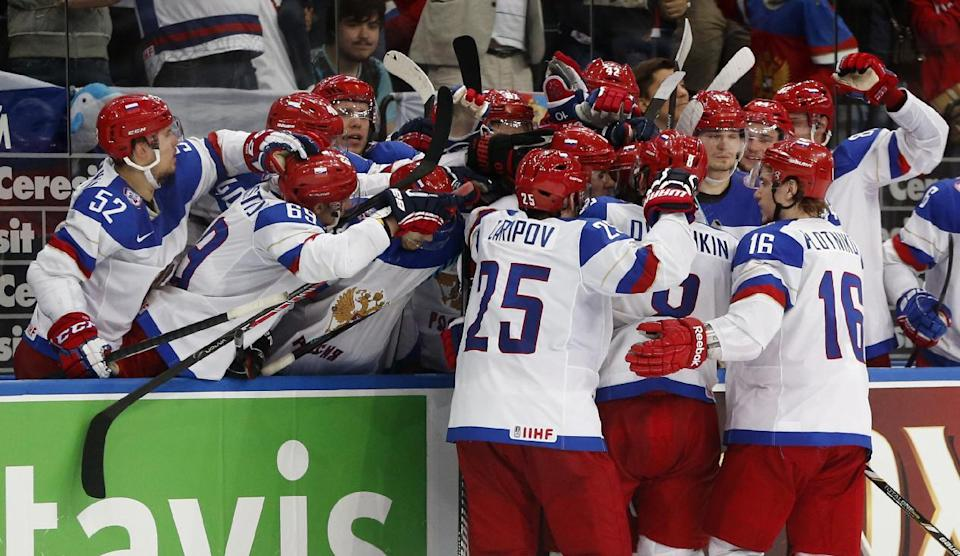 Russia players celebrate after scoring a goal during the gold medal match against Finland at the Ice Hockey World Championship in Minsk, Belarus, Sunday, May 25, 2014. (AP Photo/Darko Bandic)