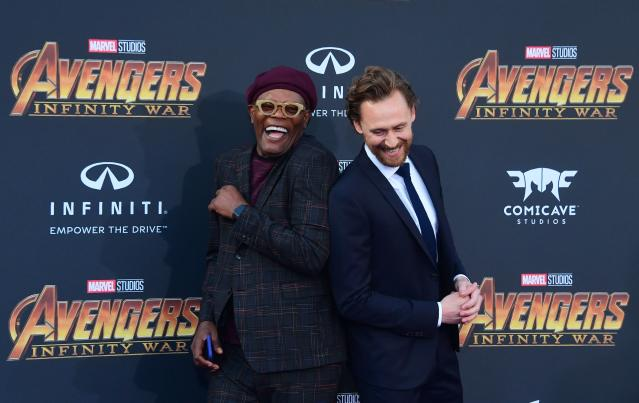 <p>Nick Fury and former nemesis Loki had a laugh while posing for photogs. (Photo: Frederic J. Brown / AFP) </p>