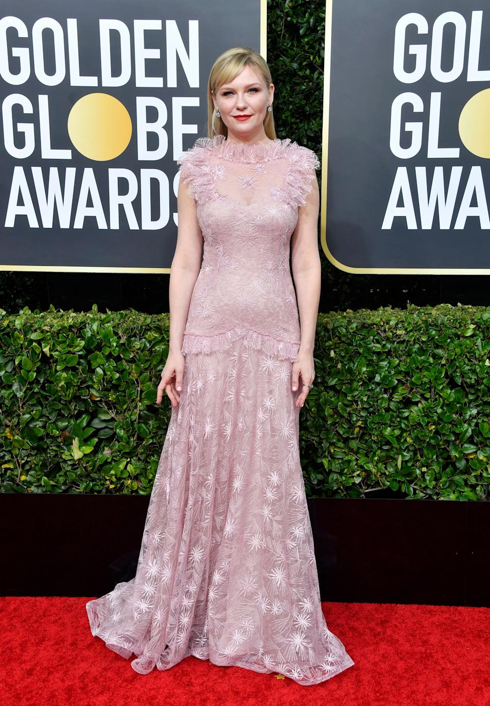 """This gorgeous Rodarte gown has all the grit and whimsy you'd expect from Kiki Dunst, who had the grace to tell the red carpet presenters that she loves the new """"Little Women."""" She's a class act, with one of the best dresses of the night."""