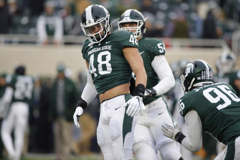 Michigan State's Kenny Willekes (48), Jack Saylor (54) and Jacub Panasiuk (96) warm up before an NCAA college football game against Maryland, Saturday, Nov. 30, 2019, in East Lansing, Mich. (AP Photo/Al Goldis)