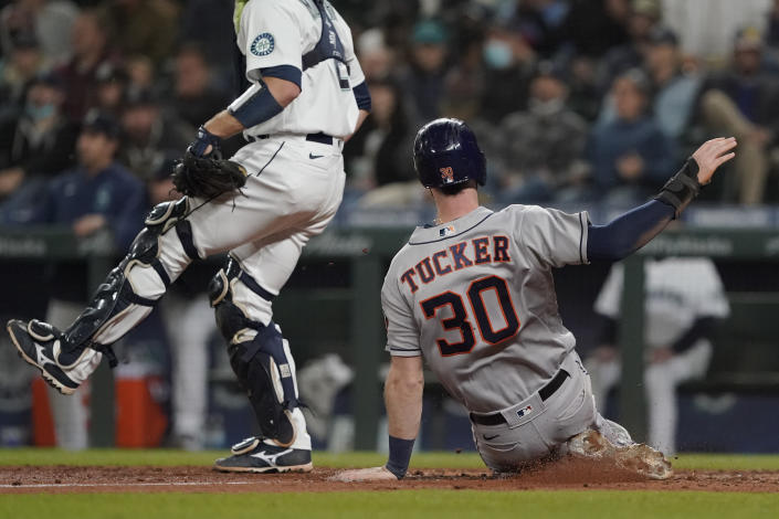 Houston Astros' Kyle Tucker (30) slides home to score on an RBI-single hit by Jake Meyers during the eighth inning of a baseball game, Monday, Aug. 30, 2021, in Seattle. (AP Photo/Ted S. Warren)