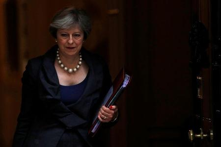 FILE PHOTO: Britain's Prime Minster Theresa May leaves 10 Downing Street in London, Britain, October 11, 2017. REUTERS/Peter Nicholls
