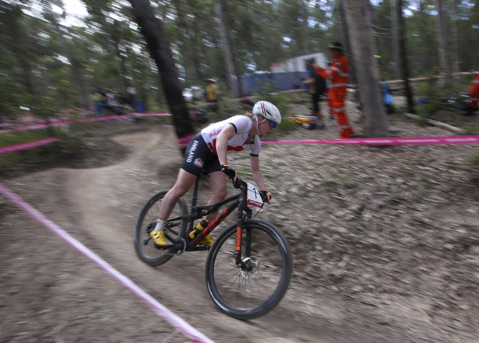 <p>England's Annie Last rides down hill during the women's cross-country race at the Nerrang mountain bike trails during the 2018 Commonwealth Games on the Gold Coast, Australia, Thursday, April 12, 2018. (AP Photo/Rick Rycroft) </p>