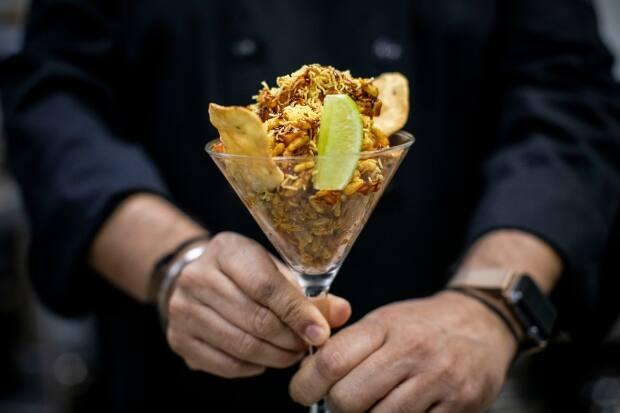 This chaat dish, called bhel puri, is made up of puffed rice, vegetables and tamarind chutney. (Ben Nelms/CBC - image credit)