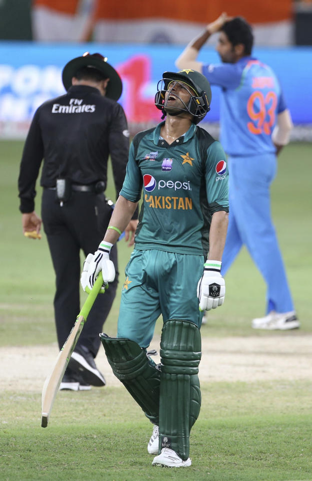 Pakistan's Shoaib Malik reacts as he leaves the field after being dismissed during the one day international cricket match of Asia Cup between India and Pakistan in Dubai, United Arab Emirates, Sunday, Sept. 23, 2018. (AP Photo/Aijaz Rahi)