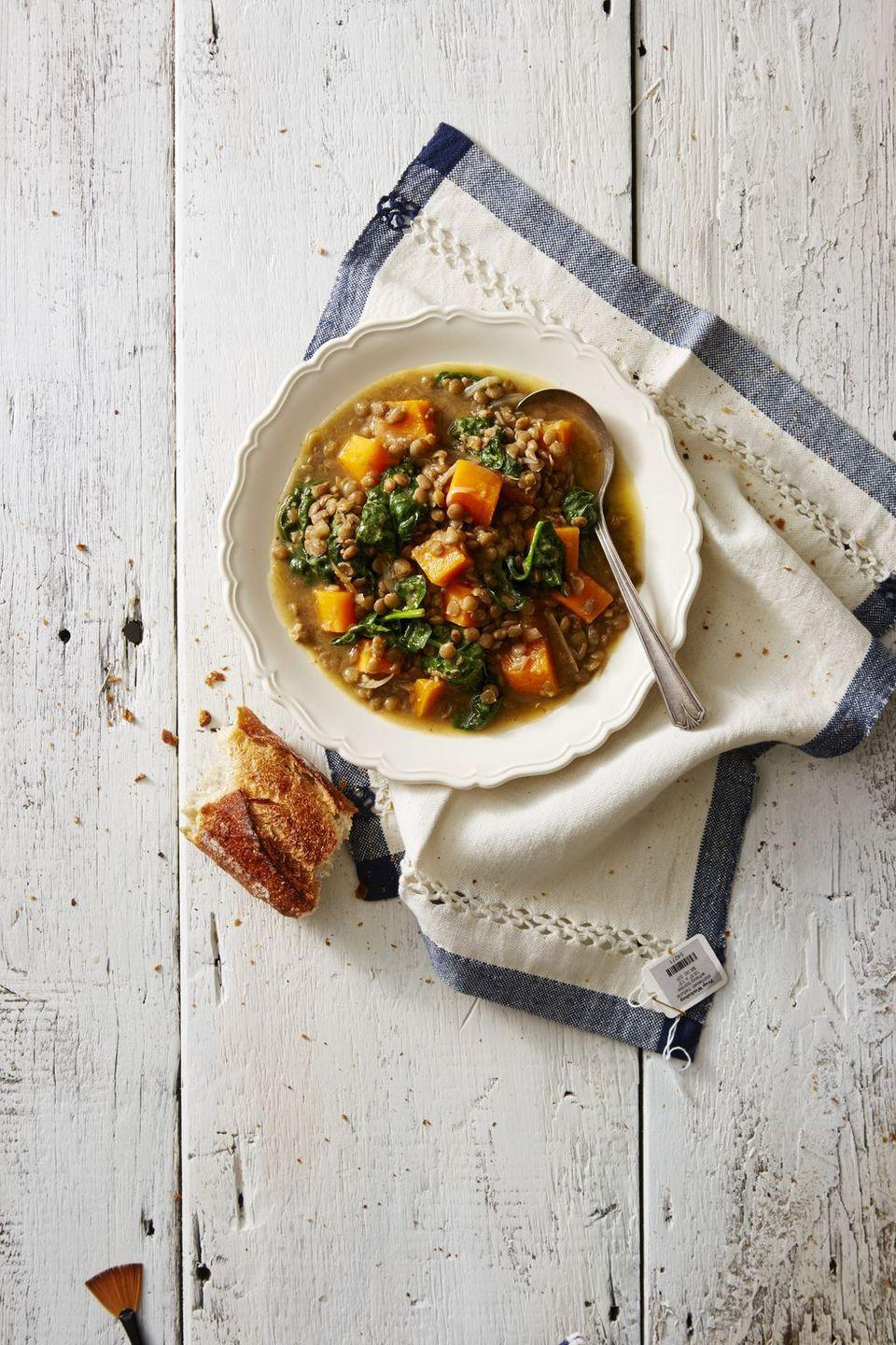 """<p>If you use a pressure cooker this recipe will finish a lot faster, but you'll still get a hearty meal with your slow cooker!</p><p><em><a href=""""https://www.goodhousekeeping.com/food-recipes/healthy/a42399/pressure-cooker-warming-winter-squash-lentil-stew-recipe/"""" rel=""""nofollow noopener"""" target=""""_blank"""" data-ylk=""""slk:Get the recipe for Pressure Cooker Winter Squash and Lentil Stew »"""" class=""""link rapid-noclick-resp"""">Get the recipe for Pressure Cooker Winter Squash and Lentil Stew »</a></em></p><p><strong>RELATED:</strong> <a href=""""https://www.goodhousekeeping.com/food-recipes/easy/g26102687/instant-pot-soups/"""" rel=""""nofollow noopener"""" target=""""_blank"""" data-ylk=""""slk:20 Instant Pot Soups That Are Basically Comfort in a Bowl"""" class=""""link rapid-noclick-resp"""">20 Instant Pot Soups That Are Basically Comfort in a Bowl</a></p>"""