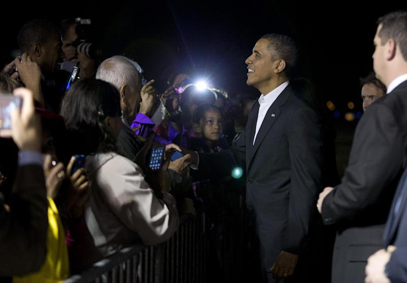 President Barack Obama greets supporters after arriving at West Palm Beach International Airport on Friday, Feb. 15, 2013, in West Palm Beach, Fla. President Obama is spending the weekend in Palm City, Fla. (AP Photo/Evan Vucci)