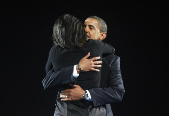Barack Obama hugs his wife Michelle during his election night rally in Chicago, November 4, 2008.
