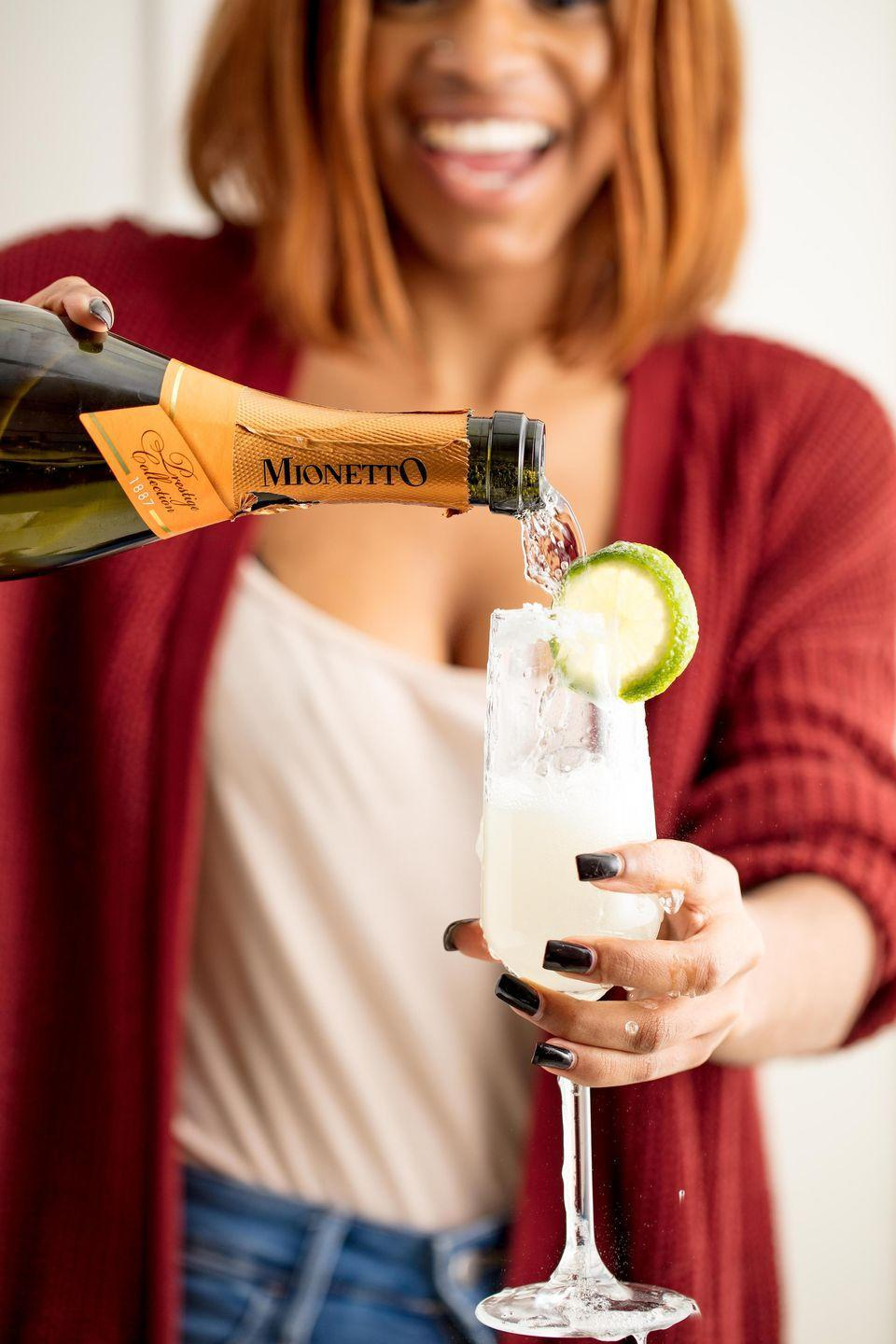 """<p>This margarita gets a festive boost with the addition of your favorite bubbly.</p><p>Get the recipe from <a href=""""https://www.delish.com/cooking/recipe-ideas/recipes/a50633/champagne-margaritas-recipe/"""" rel=""""nofollow noopener"""" target=""""_blank"""" data-ylk=""""slk:Delish"""" class=""""link rapid-noclick-resp"""">Delish</a>. </p>"""
