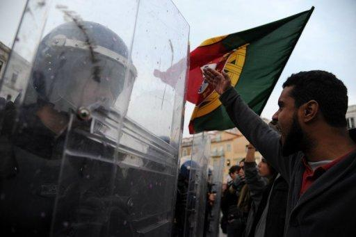 Anti-government protesters face off with police in Lisbon on November 14