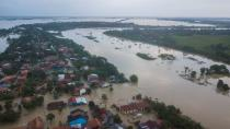 An aerial view shows a residential area affected by floods, which damaged the embankment of the Citarum river following the heavy rains, in Bekasi