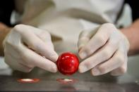 A worker prepares a pastry at the workshop of Belgian chocolate maker Marcolini, in Brussels