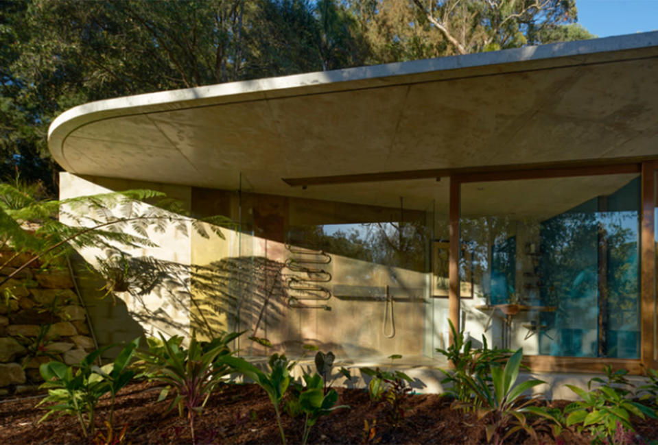 "Cabbage Tree House, 2018 house of the year, achieves a timeless façade with exposed concrete, steel and brickwork, which convey ""thermal mass"" benefits"
